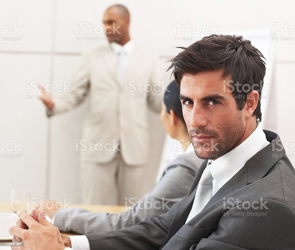 Close-up of businessman with colleagues in background royalty-free stock photo