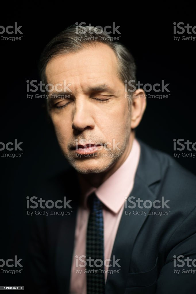 Close-up of businessman with eyes closed stock photo