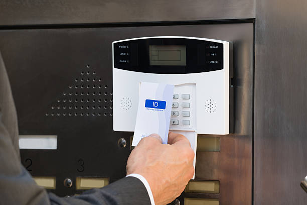 Close-up Of Businessperson Holding Keycard For Security System Close-up Of Businessperson Hands Inserting Keycard In Security System To Unlock Door security pass stock pictures, royalty-free photos & images