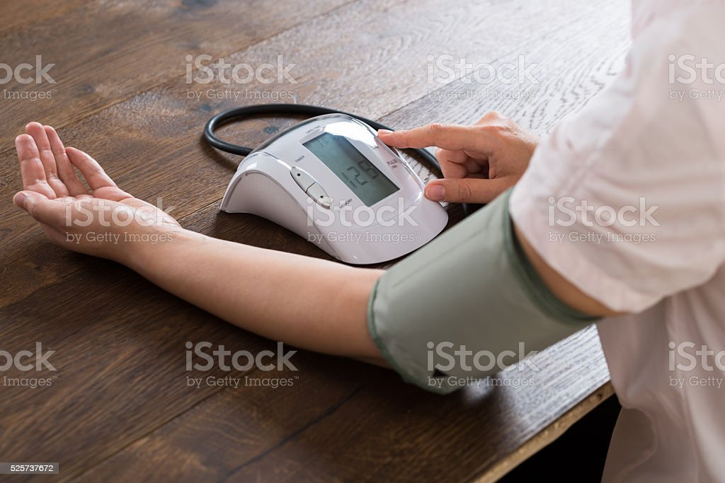 Close-up Of Businesswoman Measuring Blood Pressure stock photo