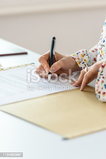 istock Closeup of businesswoman signing contract 1134883867