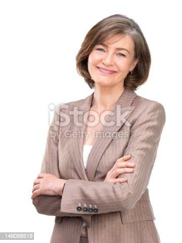 1132314350 istock photo Close-up of businesswoman smiling with arms crossed against white background 146068519