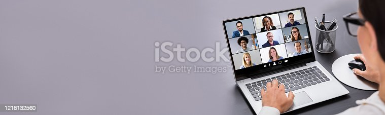 Close-up Of Businesswoman Using Digital Laptop Preparing Invoice Against Gray Background