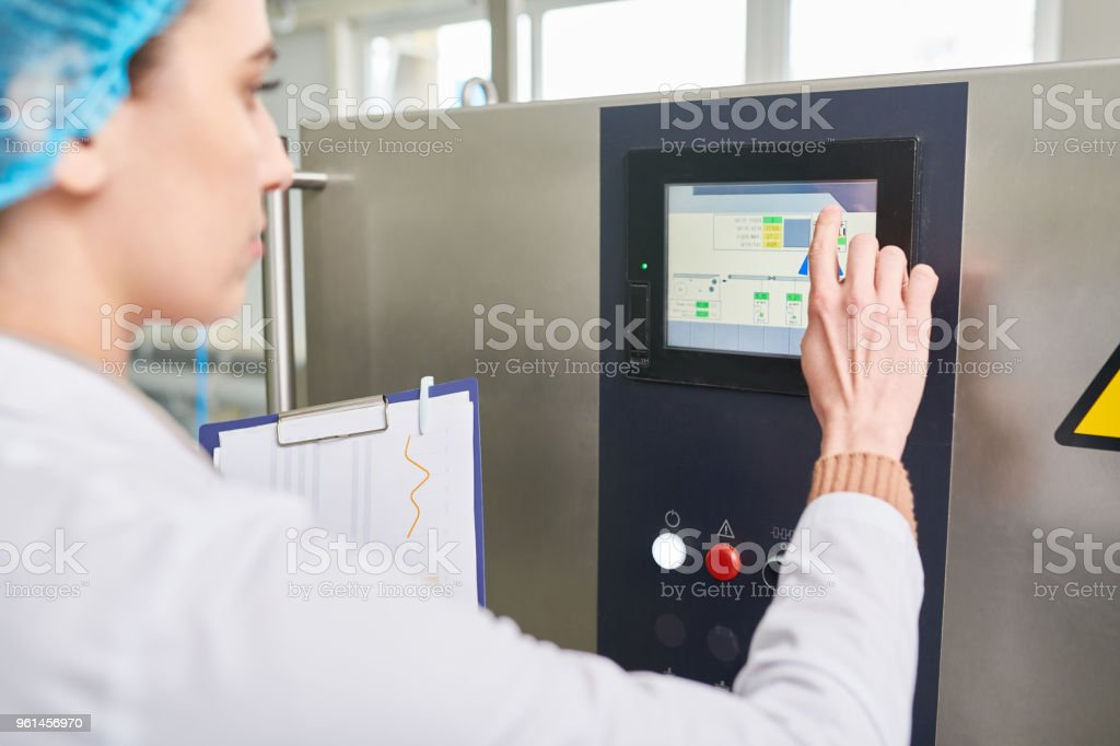 Closeup Of Busy Female Food Production Engineer Touching