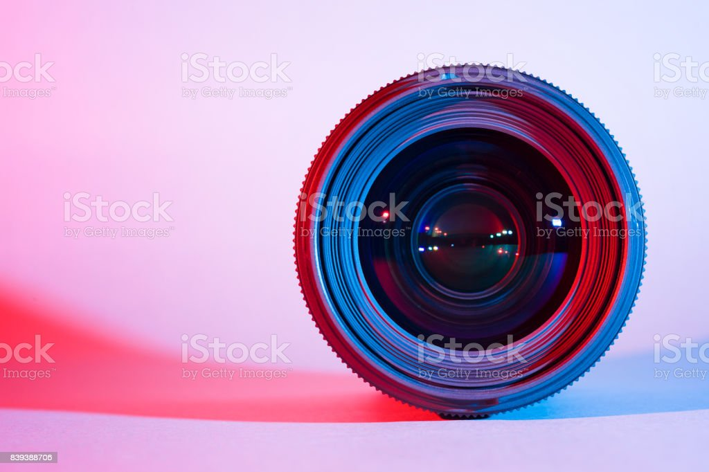 Closeup of camera lens with red and blue lighting stock photo