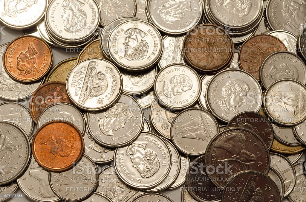 Closeup Of Canadian Coins Spread Out With Penny Stock Photo