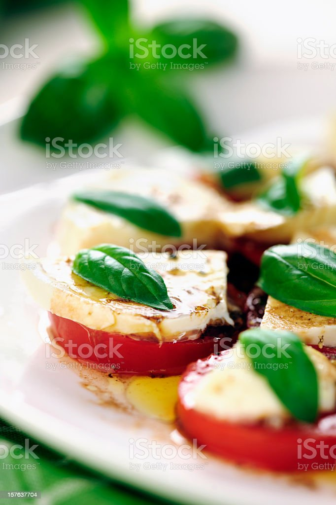 Close-up of caprese salad with tomatoes mozzarella and basil stock photo
