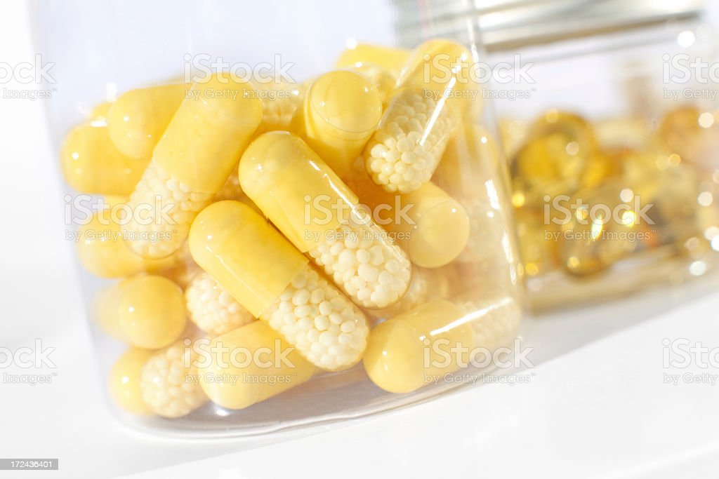 Close-up of capsules, gel pills and tablets in transparent bottles royalty-free stock photo