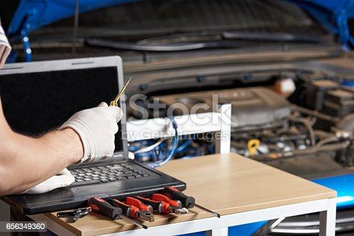 istock Closeup of car mechanic hands 656349360