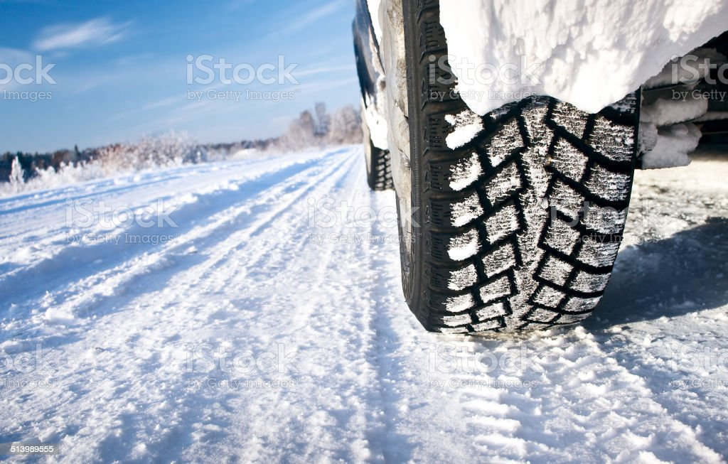 Closeup of car tires in winter morning stock photo