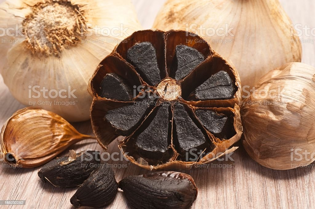 Close-up of caramelized flesh of black garlic stock photo