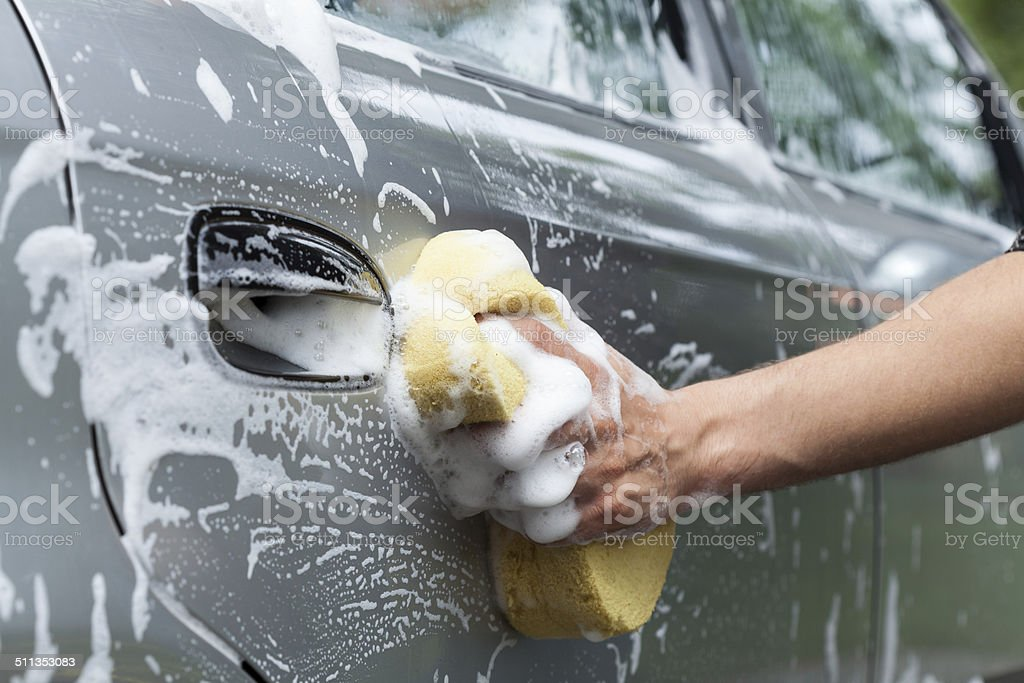 Close-up of car's door cleaning stock photo