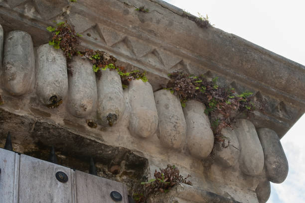Close-up of carvings that look like artillery shells on a building stock photo