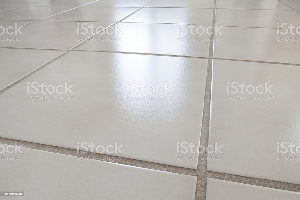 closeup of ceramic tile floor with reflection from window stock photo