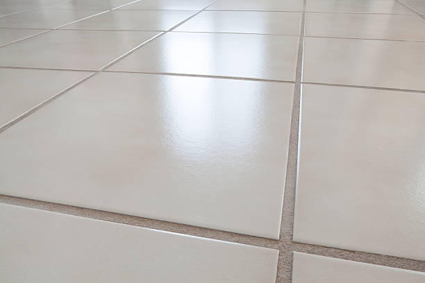 closeup of ceramic tile floor with reflection from window - low contrast stock pictures, royalty-free photos & images