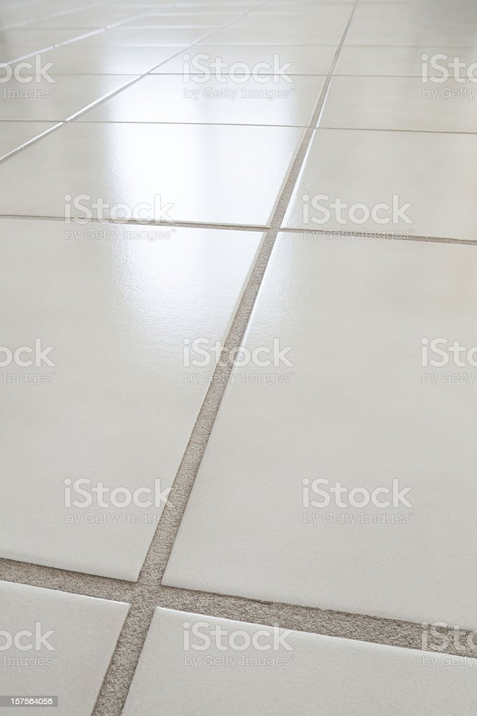 closeup of ceramic tile floor with reflection from window royalty-free stock photo