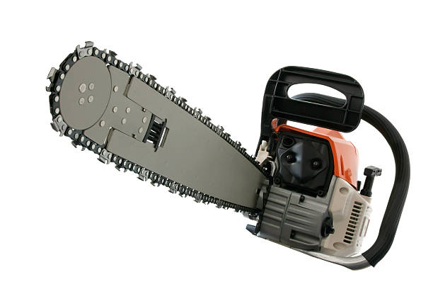 close-up of chain saw isolated on white background - chainsaw stock photos and pictures
