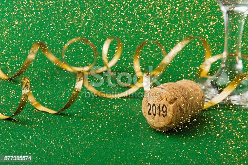 istock Closeup of champagne cork with numbers 2018 new year on green background 877385574