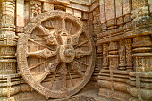 Close-up of chariot wheel intricate carvings in the ancient Hindu Sun Temple in Konark, Orissa, India. 13th-century CE. The temple is attributed to king Narasingha deva I of the Eastern Ganga Dynasty