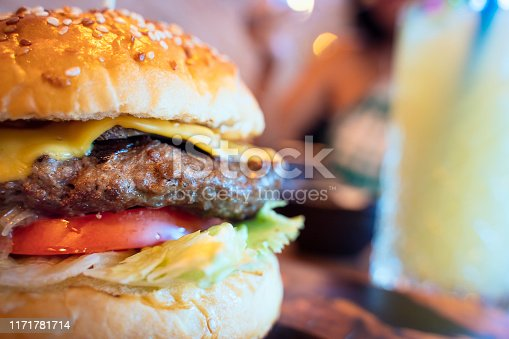Close-up of Cheeseburger in restaurant