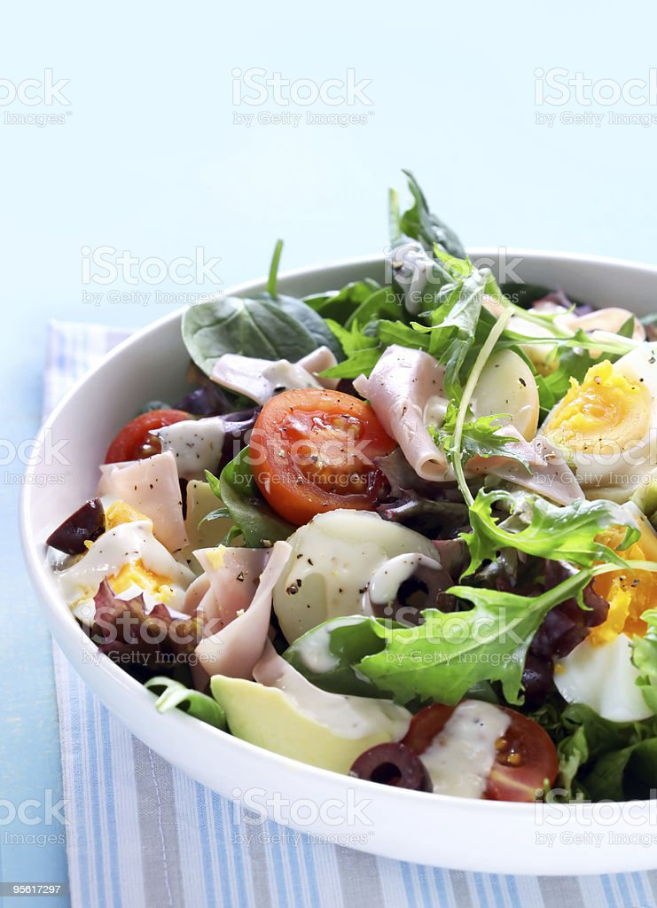 Close-up of Chefs Salad served in white ceramic bowl stock photo