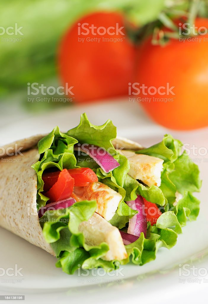 Closeup of chicken wrap sandwich with lettuce and onions royalty-free stock photo