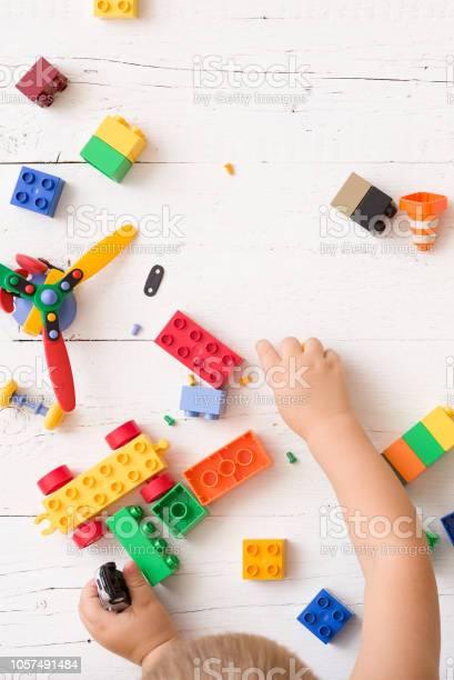 Closeup of childs hands playing with multicolor plastic bricks on picture id1057491484?b=1&k=6&m=1057491484&s=612x612&h=3dcb12 xgbx4kiz237d4pi2x4maz7iacrniara5m8ks=