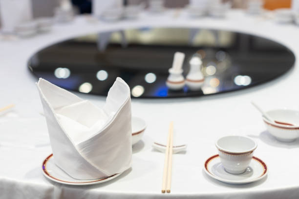 closeup of Chinese dinner wedding table setting in a restaurant, selective focus. closeup of Chinese dinner banquet wedding table setting in a restaurant, selective focus. chinese wedding dinner stock pictures, royalty-free photos & images