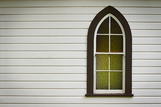 Closeup of church window with green light inside
