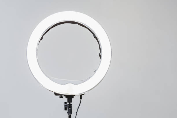 Closeup of circular neon LED lamp at white background. Popular modern light for make-up and beauty portraits stock photo