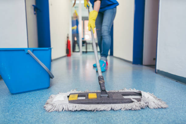 Close-up of cleaners moping the floor stock photo