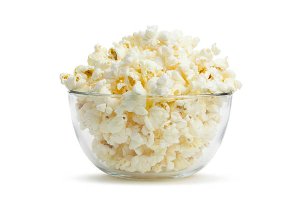 close-up of clear bowl with freshly popped corn - kase stok fotoğraflar ve resimler