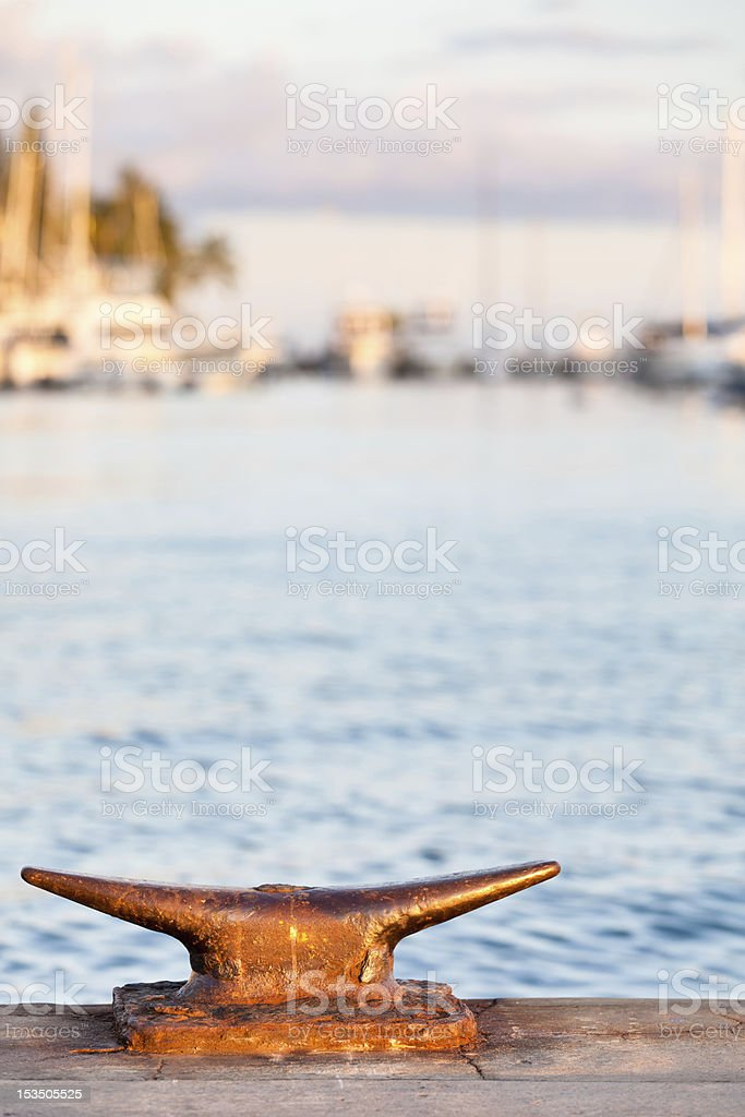 Close-up of Cleat with Lahaina Harbor in Background stock photo