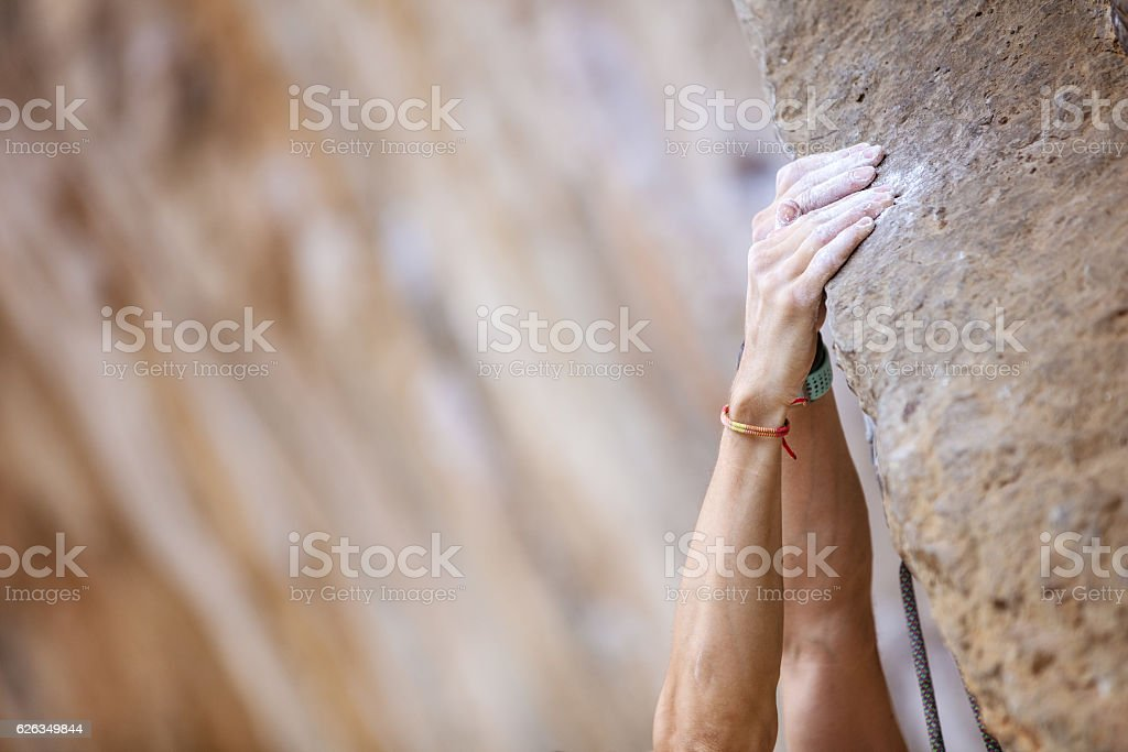 Closeup of climber's hands stock photo