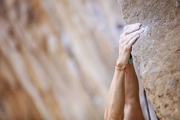 Closeup of climber's hands stock photo