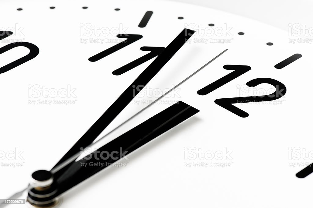 Close-up of clock face that reaches deadline royalty-free stock photo