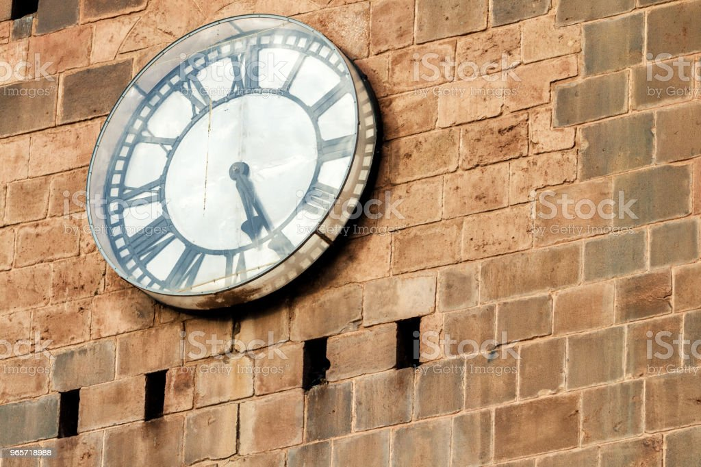 Close-up of clock with Roman numerals on the stone wall of the Cathedral of Cusco (Peru) - Royalty-free Ancient Stock Photo
