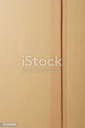istock Close-up of closed cardboard box with adhesive tape 181094806