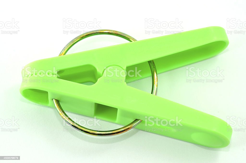 Closeup of clothes clips or pin in light green color stock photo