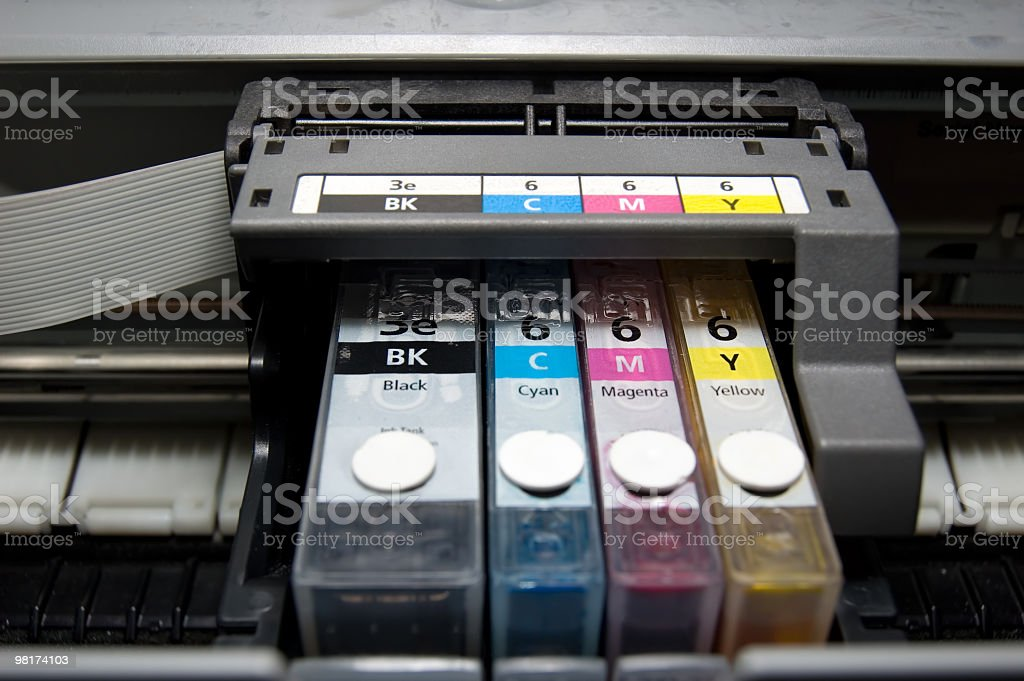 Close-up of CMY color and black ink cartridges in a printer stock photo