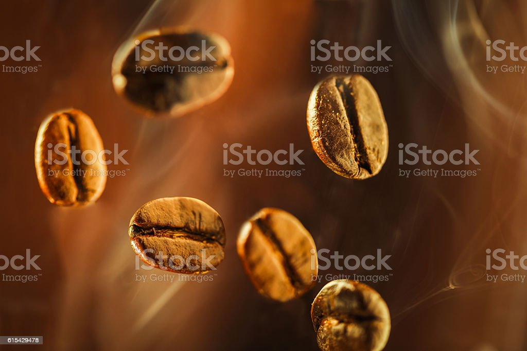Closeup of coffee beans floating in the smoke stock photo