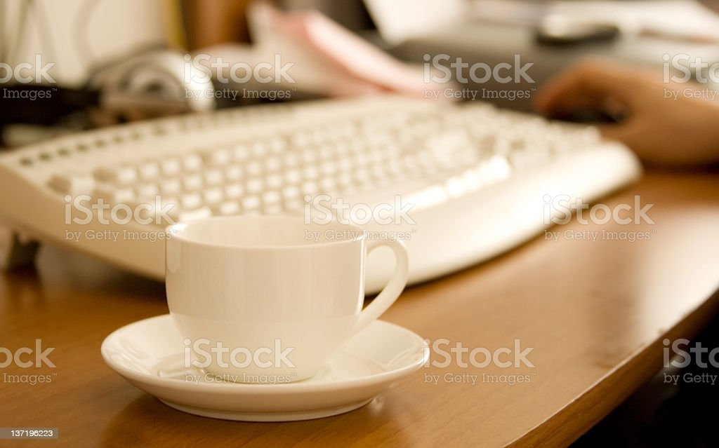 Closeup of coffee cup on workplace royalty-free stock photo