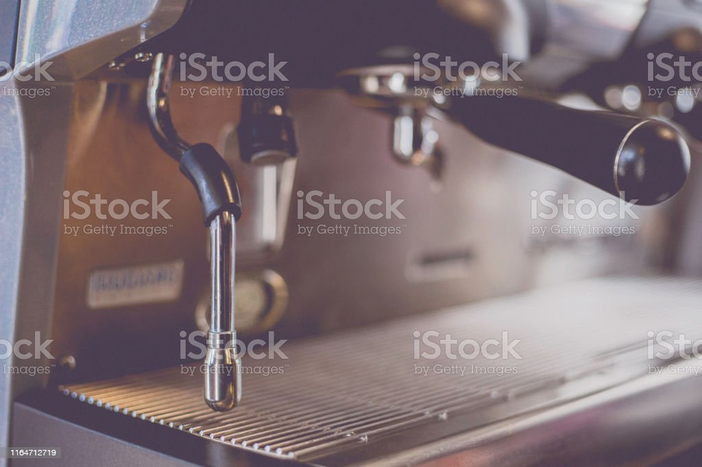 Close-Up of coffee machine in the coffee shop. Len blur effect. Soft...