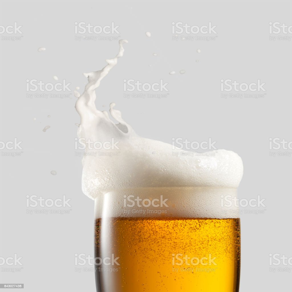Close-up of cold beer with foam stock photo