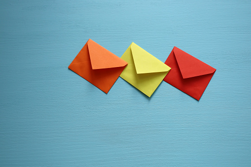 Close-up of color envelopes on blue background