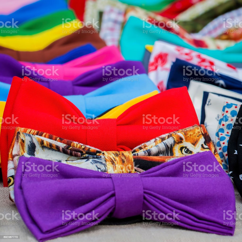 Close-up of colorful bow ties for hipsters, creative subculture. Vivid picturesque backdrop for square wallpaper, design, web, banner, poster, selective focus stock photo