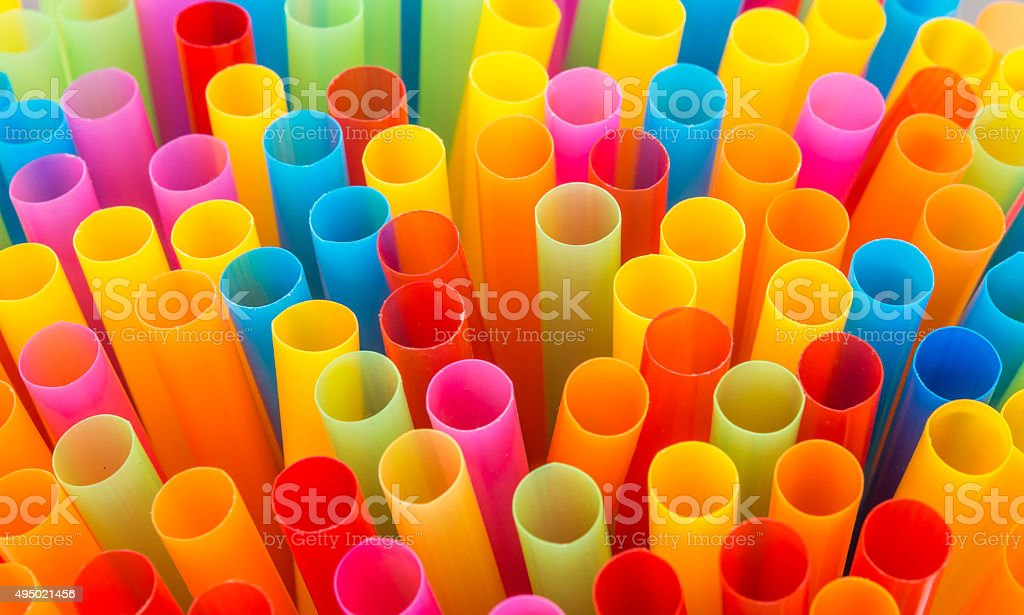 Closeup of Colorful drinking straws background. stock photo