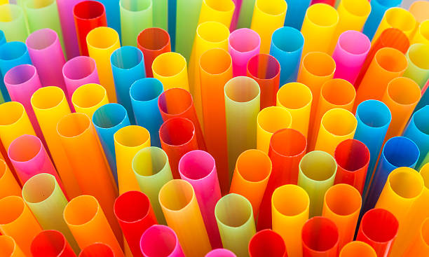 Closeup of Colorful drinking straws background. Closeup of Colorful drinking straws background. drinking straw stock pictures, royalty-free photos & images