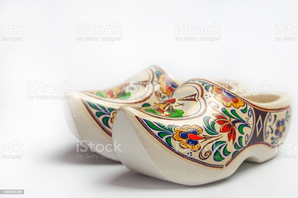 Closeup of colorful painted clogs, the traditional Dutch wooden shoes on white background stock photo