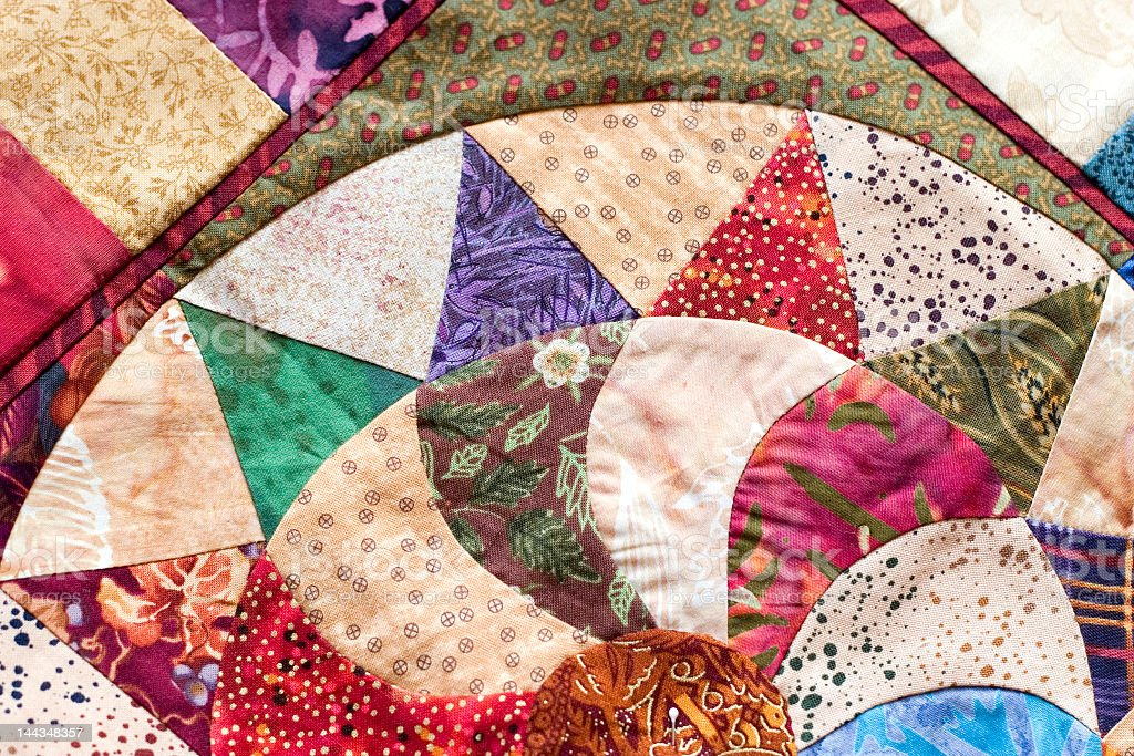Close-up of colorful quilt made of different shapes stock photo